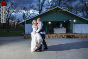 Bow Ty Audio DJs in Bellevue, NE while the bride and groom share a kiss